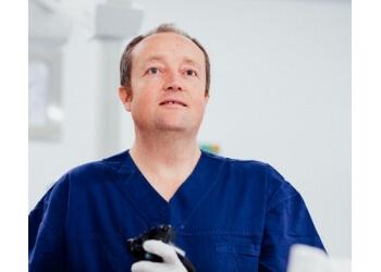 Dr. Andrew Brett