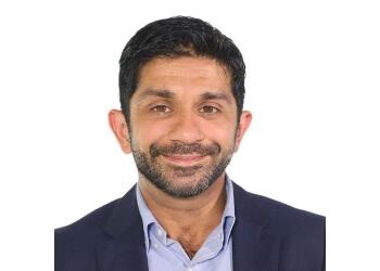 Dr. Aziz Bhimani