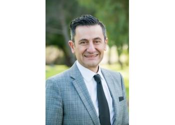 Dr. Con Laparidis