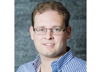 Dr. Edwin Auzins