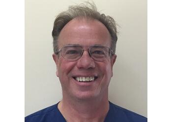 Dr. Ian Scholes