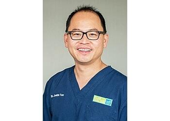 Dr. Justin Tan