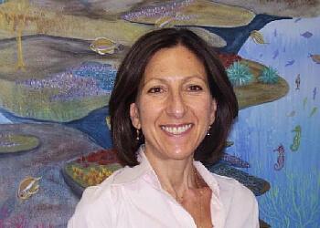 Dr. Katina Routsios