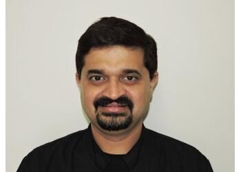 Dr. Kedar Samant