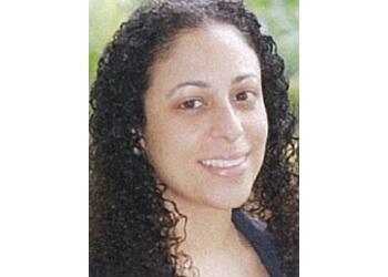 Dr. Neva Shebini