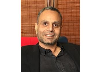 Dr. Ravi Tewari