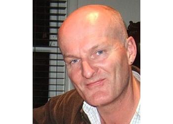 Dr. Tim Loughnan