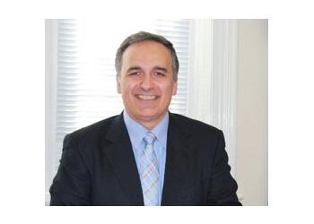 Dr. Tom Savvoulidis