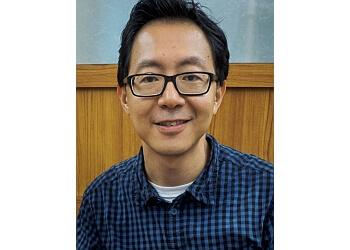 Dr. Vincent Au
