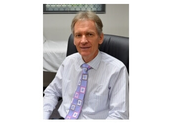 Dr. Ian Tassan